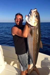 Vainqueur du concours photo du mois d'Octobre 2016, pêche d'une sériole avec un joli vif en Corse du sud